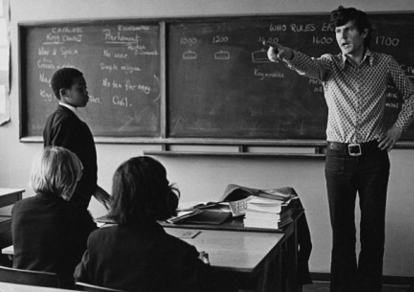 Old school teacher pointing his finger
